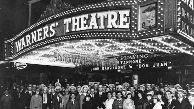"This 1926 image shows crowds posing outside Warner's Theatre in New York for the 1926 opening of John Barrymore in ""Don Juan.""  This silent film's synchronized score led directly to the breakthrough talkie, ""The Jazz Singer,"" the following year. For every clever man who invents a labor-saving machine, it seems a crowd of angry men rises up to destroy it. In the 1930s, silent films were being replaced by ""talkies,"" and musicians who played in movie theaters across the country were losing work. So their union launched a smear campaign. It took out ads calling the music ""canned"" and urged people to insist on the live variety.  (AP Photo)"