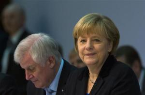 CDU head German Chancellor Merkel and CSU head Seehofer attend coalition talks with SPD in Berlin