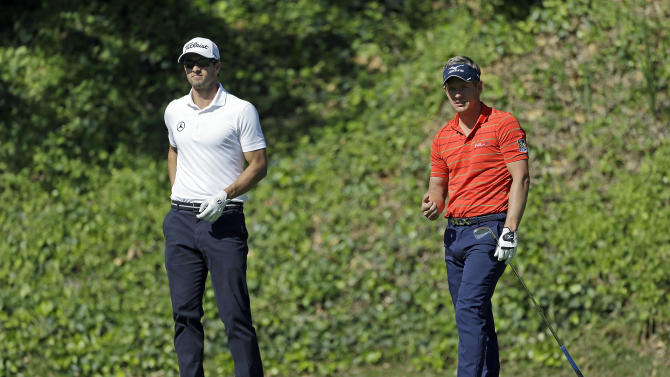Luke Donald, of England, right, and Adam Scott, of Australia, watch Donald's drive on the sixth tee in the second round of the Northern Trust Open golf tournament at Riviera Country Club in the Pacific Palisades area of Los Angeles Friday, Feb. 15, 2013. (AP Photo/Reed Saxon)