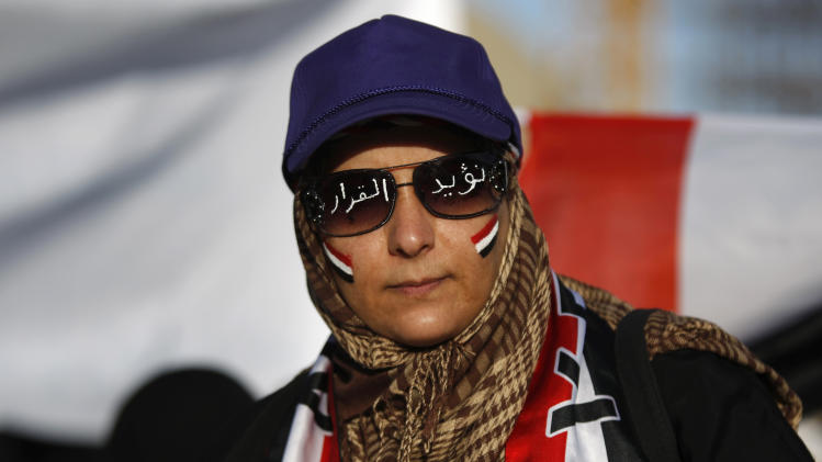 "A female protestor with Yemen's flag painted on her face and Arabic writing on sunglasses that reads, ""we support the decision,"" during a rally to show support for President Abed Rabbu Mansour Hadi, in Sanaa, Yemen, Thursday, Dec. 20, 2012. (AP Photo/Hani Mohammed)"