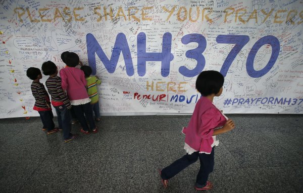 Malaysia widens search for missing plane