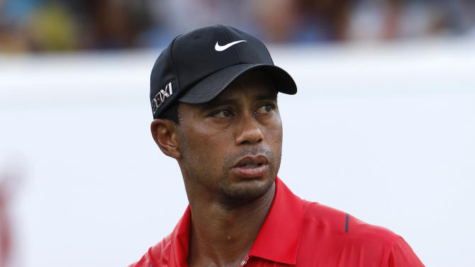 Tiger Woods of the United States walks on the 18th hole after he completed the final round of the CIMB Classic golf tournament at the Mines Resort and Golf Club in Kuala Lumpur, Malaysia, Sunday, Oct. 28, 2012.  (AP Photo/Vincent Thian)