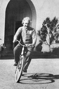 Albert Einstein riding a bike. Public domain.