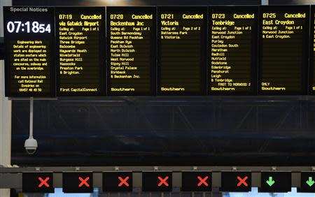 The notice board at London Bridge Station shows all trains cancelled during rush hour in London