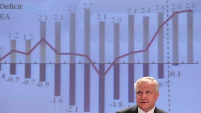 European Commissioner for Economic and Monetary Affairs Olli Rehn addresses the media at the European Commission headquarters in Brussels, Friday, May 3, 2013. The European Union is predicting that the recession in the Eurozone will continue in 2013 and that unemployment will stand at record levels. In Friday's spring economic forecast, the EU said that gross domestic product in the 17 nations that use the euro currency will shrink by 0.4 percent this year, slightly better that the estimated -0.6 percent for last year. (AP Photo/Yves Logghe)