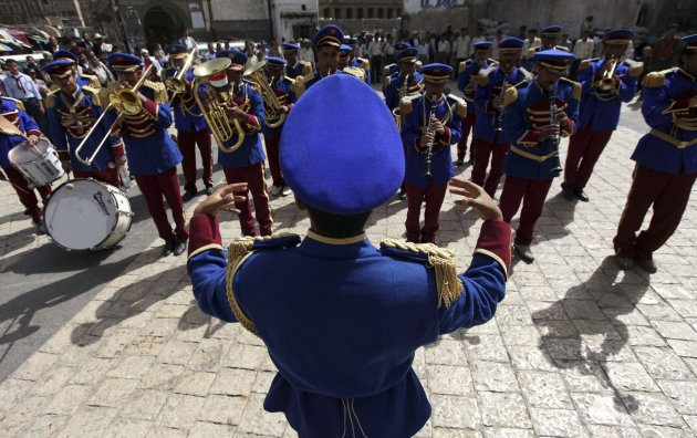 Members of the military band play during a performance marking the 23rd anniversary of Yemen's reunification in Sanaa