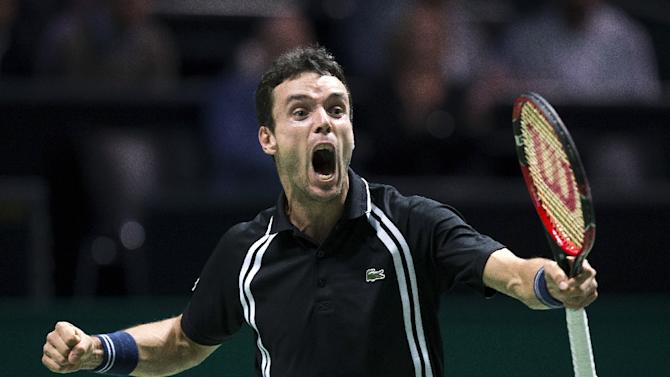 Spanish Roberto Bautista Agut celebrates after winning against Czech Republic's Jiri Vesely during the World Tennis Tournament in Rotterdam, on February 11, 2016