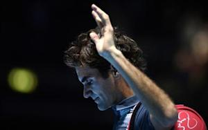 Roger Federer of Switzerland waves to the crowd after losing to Rafael Nadal of Spain in their men's singles tennis match in London