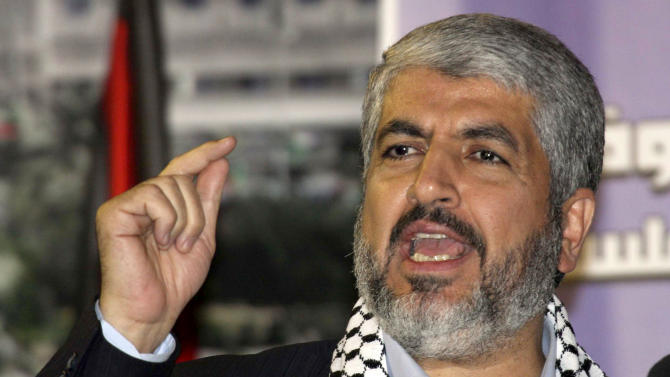 FILE - In this Friday Nov. 5, 2010, file photo, the leader of Hamas Khaled Mashaal addresses the crowd during a rally at the Yarmouk refugee camp near Damascus, Syria, Hamas' exiled supreme leader visits the Gaza Strip for the first time this weekend on a landmark trip to the sliver of land ruled by his Islamic militant movement. The visit signals growing regional acceptance of the once isolated Hamas and even grudging acquiescence by Israel in the wake of an eight-day battle last month that ended with a cease-fire between the bitter enemies. (AP Photo/Bassem Tellawi, File)