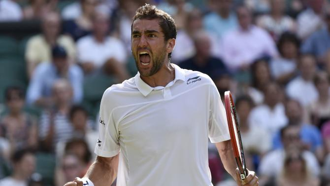 Marin Cilic of Croatia celebrates after winning the third set of his match against Ricardas Berankis of Lithuania at the Wimbledon Tennis Championships in London