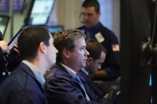 <p>Traders work on the floor of the New York Stock Exchange minutes before the closing bell on October 1. US stocks closed mixed after a day of bumpy trade Tuesday, with the Nasdaq gaining ground while the Dow blue chips bowed to selling pressure.</p>