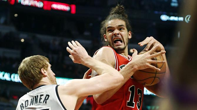Chicago Bulls center Joakim Noah (13) loses control of the ball as San Antonio Spurs power forward Matt Bonner defends during the first half of an NBA basketball game, Monday, Feb. 11, 2013, in Chicago. (AP Photo/Charles Rex Arbogast)