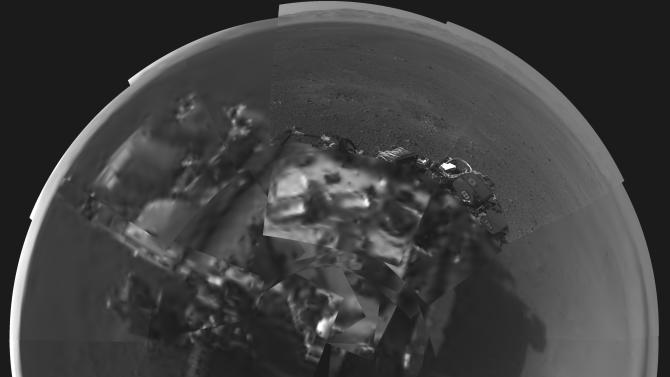In this image released by NASA on Wednesday, Aug. 8, 2012, a self portrait of NASA's Curiosity rover was taken by its Navigation cameras, located on the now-upright mast. The camera snapped pictures 360-degrees around the rover. (AP Photo/NASA)