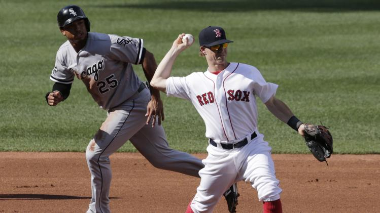 Boston Red Sox third baseman Brock Holt, right, fields a ground out by Chicago White Sox' Leury Garcia during the second inning of a baseball game at Fenway Park in Boston, Thursday, July 10, 2014. At left is White Sox Moises Sierra, who was trying to advance to third on the inning ending play. (AP Photo/Charles Krupa)