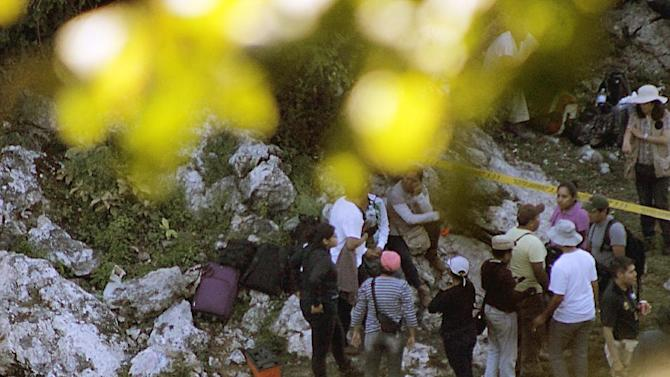 Forensic personnel arrive at the scene where a new mass grave has been discovered in a trash dump on the outskirts of Cocula, Guerrero state, Mexico on October 27, 2014