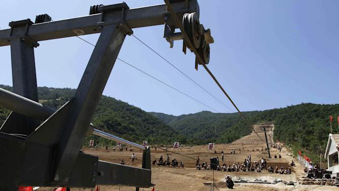 """In this Aug. 23, 2013 photo, North Korean soldiers work on at building project to construct a ski resort at North Korea's Masik Pass. North Korean authorities have been encouraging a broader interest in sports in the country, both at the elite and recreational levels, as a means of energizing and mobilizing the masses, which North Korea's slogan spinners are calling """"the hot wind of sports blowing through Korea."""" (AP Photo/Kim Kwang Hyon)"""