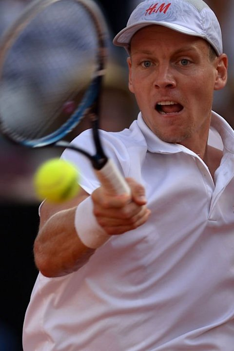 Czech Republic's Tomas Berdych returns a ball to Spain's Rafael Nadal on May 18, 2013 in Rome