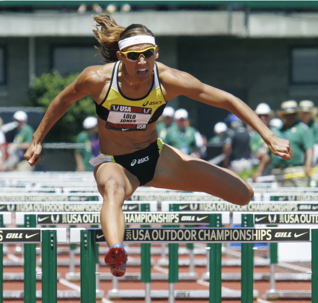 Lolo Jones clears the last hurdle on her way to qualifying in a preliminary heat of the 100 hurdles during the U.S. track and field championships in Eugene, Ore., Saturday, June 25, 2011. Jones will c