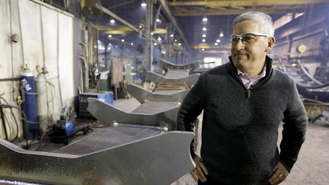 Cedar Fair CEO Matt Ouimet tours the Clermont Steel Fabricating plant, Wednesday, Jan. 9, 2013, in Batavia, Ohio. Ouimet is encouraged about the company's future and the industry and believes one key is keeping people happy. He said the company's new dramatic roller coaster under construction in southwest Ohio will help achieve that goal. (AP Photo/Al Behrman)