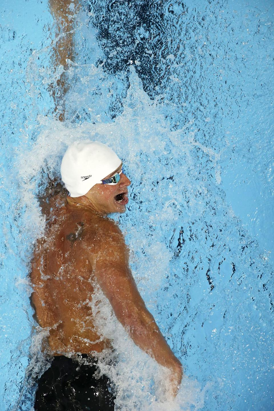 Ryan Lochte swims in the men's 200-meter freestyle preliminaries at the U.S. Olympic swimming trials, Tuesday, June 26, 2012, in Omaha, Neb. (AP Photo/Mark Humphrey)