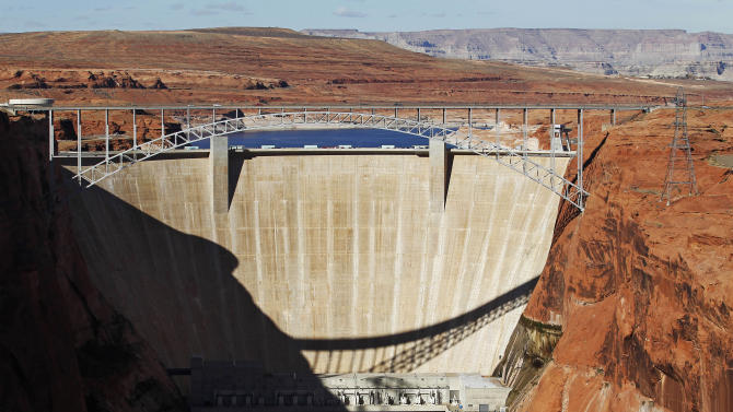 This Nov. 19, 2012 file photo shows the high-flow release of water into the Colorado River from bypass tubes at Glen Canyon Dam in Page, Ariz. An advocacy group is calling the Colorado River the nation's most endangered waterway. An annual American Rivers report being released Wednesday April 17, 2013, doesn't call pollution the problem. It instead cites drought and demand.  (AP Photo/The Arizona Republic, Rob Schumacher, file)  MARICOPA COUNTY OUT; MAGS OUT; NO SALES