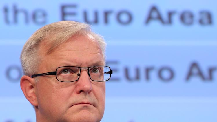 European Commissioner for Economic and Monetary Affairs Olli Rehn addresses the media as he presents a blueprint for a deep and genuine economic and monetary union, at the European Commission headquarters in Brussels, Wednesday, Nov. 28, 2012. (AP Photo/Yves Logghe)