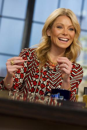 "In this Jan. 24, 2012 photo, Kelly Ripa tapes an episode of ""Live! with Kelly,"" in New York. The producers of ""Live! With Kelly"" say a new co-host will be revealed on the show Sept. 4. Ripa that morning will officially announce her new partner as he or she joins her on stage. By then, Ripa will have welcomed 59 guest co-hosts since Regis Philbin retired from the show last November, Disney-ABC Domestic Television said Monday, Aug. 20, 2012. The chosen one will come for that large pack, the company said. (AP Photo/Charles Sykes)"