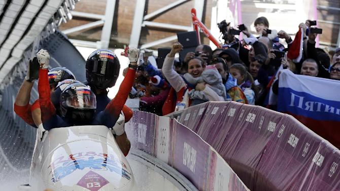 Zubkov wins double bobsled gold for Russia