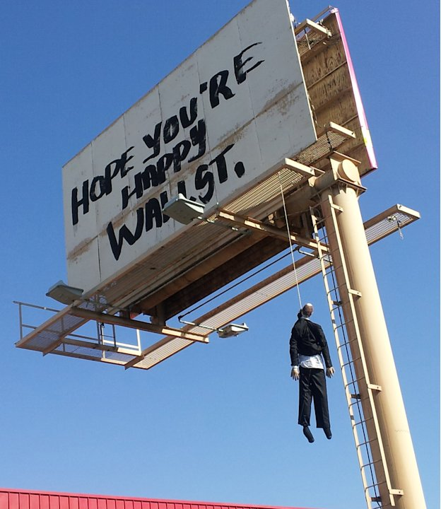 This image provided by KVVU-TV shows a billboard with a mannequin dangling from a hangman's noose near The Strip in Las Vegas. Authorities said calls began coming in early Wednesday Aug. 8, 2012, from