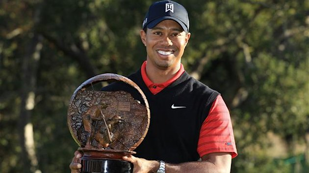 Tiger Woods poses with the trophy after winning the Chevron World Challenge at Sherwood Country Club on December 4, 2011 in Thousand Oaks, California