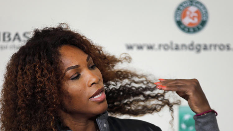 Serena Williams of the United States adjusts her hair during a press conference for the 2013 French Open tennis tournament, at Roland Garros stadium in Paris, Friday May, 24, 2013. (AP Photo/Christophe Ena)