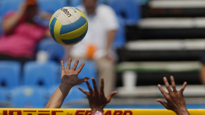 Brazil's Larissa Franca, left, and Puerto Rico's Yarleen Santiago, right, compete in a women's beach volleyball semifinal match at the Pan American Games in Puerto Vallarta, Mexico, Thursday Oct. 20, 2011. (AP Photo/Ariana Cubillos)