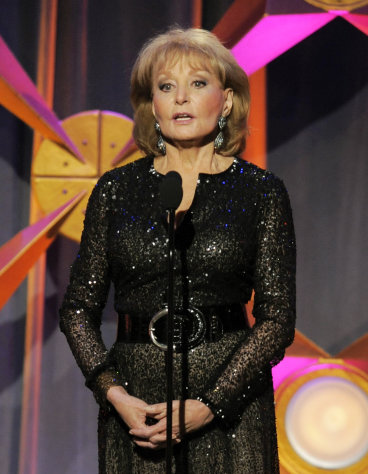 FILE - This June 23, 2012 file photo shows Barbara Walters presenting an award onstage at the 39th Annual Daytime Emmy Awards in Beverly Hills, Calif. Walters has the chickenpox and remains hospitalized more than a week after going in after falling and hitting her head at a pre-inaugural party in Washington on Jan. 19. A fellow host on the The View, Whoopi Goldberg, said Monday, Jan. 28, that Walters has been transferred to a New York hospital and hopes to go home soon. (Photo by Chris Pizzello/Invision/AP, file)