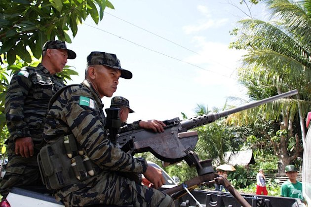 rebels man a machine gun in Sultan Kudarat, on the southern Philippine