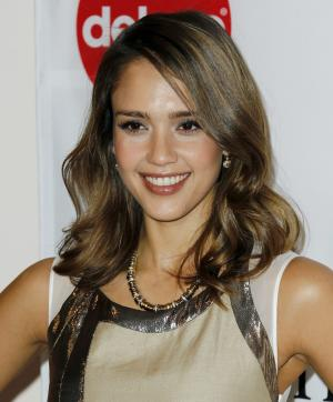 "FILE - In this Dec. 2, 2011 file photo, actress Jessica Alba arrives at the March of Dimes 6th Annual Celebration of Babies Luncheon in Beverly Hills, Calif. Alba is among the celebrities who will be heard reciting poetry this month on Disney Channel and Disney Junior as part of its ""A Poem Is ..."" series in connection with National Poetry Month. (AP Photo/Matt Sayles, file)"