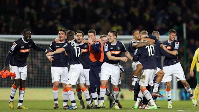 Luton Town players celebrate defeating Norwich City 0-1 in their English FA Cup fourth round soccer match at Carrow Road, Norwich, England, Saturday Jan. 26, 2013. See PA Story SOCCER Norwich. (AP Photo/PA, Chris Radburn) UNITED KINGDOM OUT  NO SALES  NO ARCHIVE
