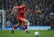 England midfielder Steven Gerrard, seen here in April 2012, ruled out retiring from international football after Euro 2012