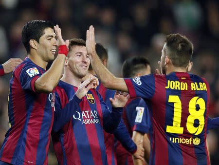 Barcelona's Lionel Messi, Luis Suarez and Jordi Alba celebrate a goal against Cordoba during their Spanish First division soccer match in Barcelona