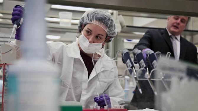 a criminalist, training in forensic science, prepares sample bone fragments for DNA testing