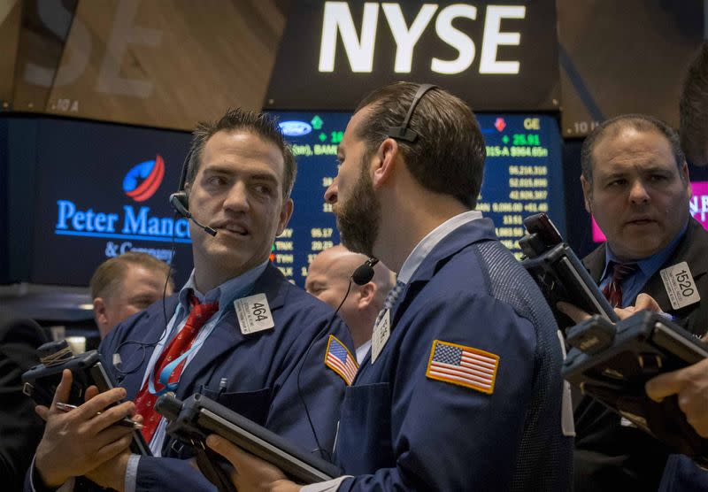Wall St ends lower as jobs data may bring rate hike sooner