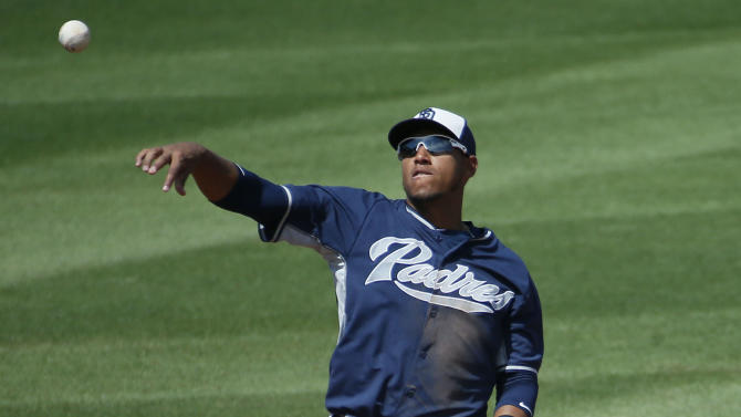 San Diego Padres' Yangervis Solarte throws to first against the Cincinnati Reds during the fourth inning of a spring training baseball game, Monday, March 30, 2015, in Goodyear, Ariz. (AP Photo/Matt York)