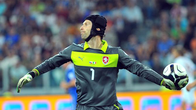 FILE - In this Sept. 10, 2013 file photo Czech Republic goalkeeper Petr Cech in action during the 2014 World Cup Group B qualifying soccer match between Italy and Czech Republic at the Juventus stadium, in Turin, Italy. The tournament in Brazil will be a poorer spectacle without Zlatan Ibrahimovic strutting his stuff for Sweden, or Welshman Gareth Bale leaving defenders in his wake with his searing pace. Prolific scorer Robert Lewandowski of Poland, Czech goalkeeper Peter Cech and rising Danish star Christan Eriksen will also be missing from the showcase tournament. (AP Photo/Massimo Pinca)