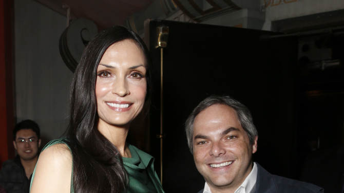 "Famke Janssen and President, Paramount Film Group Adam Goodman arrive at the premiere of ""Hansel & Gretel Witch Hunters"" on Thursday Jan. 24, 2013, in Los Angeles.  (Photo by Todd Williamson/Invision/AP)"