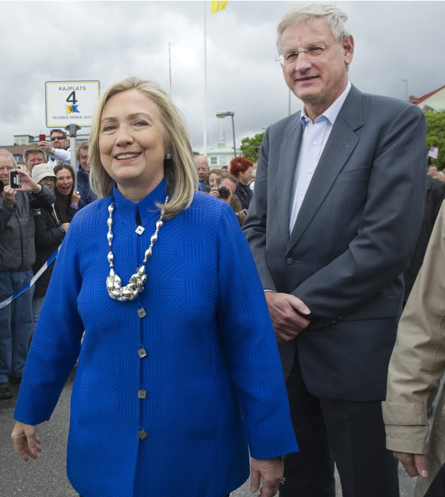 US Secretary of State Hillary Rodam Clinton, left, and Swedish Foreign Minister Carl Bildt at Vaxholm Island near Stockholm, Sweden, Sunday June 3, 2012. Clinton and Bildt took a boat from Stockholm to the 16th Century fortress town to pick up Swedish Defense Minister Karin Enstrom (not shown) for a meeting on the boat trip back to the city.