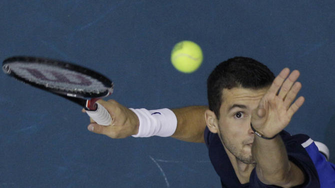 Grigor Dimitrov of Bulgaria serves to Andy Murray of Great Britain during their quarterfinal match of the Thailand Open tennis tournament in Bangkok, Friday, Sept. 30, 2011. (AP Photo/Sakchai Lalit)