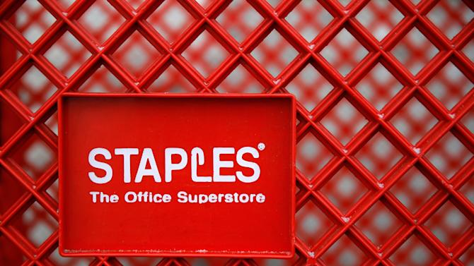 A shopping cart is seen outside a Staples office supplies store in the Chicago suburb of Glenview