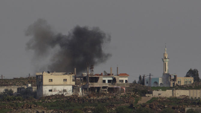 Smoke rises following an explosion in the Syrian village of Jamlah in the southern province of Daraa, Syria, seen from the Israeli-controlled Golan Heights ,Thursday, March 7, 2013. Clashes between Syrian troops and rebel fighters flared on Thursday near an area where armed fighters linked to the opposition abducted 21 U.N. peacekeepers a day earlier. The peacekeepers are part of a force that monitors a cease-fire between Israeli and Syrian troops in the Golan Heights. Israel captured part of the territory in the 1967 Mideast war, and while the area has been peaceful for decades, Israeli officials have grown increasingly jittery as the Syrian civil war moves closer to its borders. (AP Photo/Ariel Schalit)
