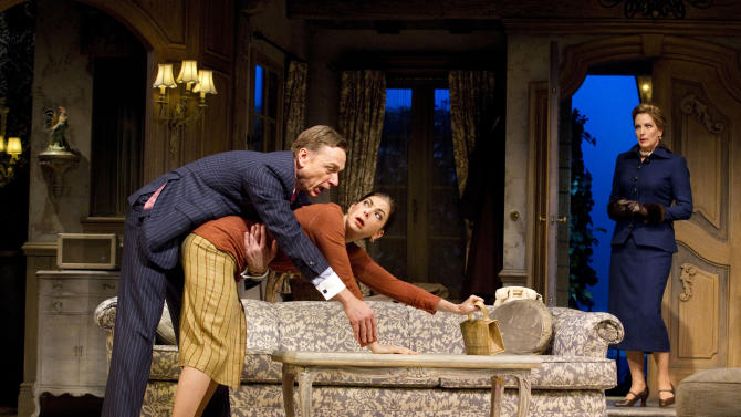 """In this theater image released by Boneau/Bryan-Brown, Ben Daniels, left, Spencer Kayden, center, and Patricia Kalember are shown in a scene from the Roundabout Theatre Company's """"Don't Dress for Dinner,"""" in New York. (AP Photo/Boneau/Bryan-Brown, Joan Marcus)"""