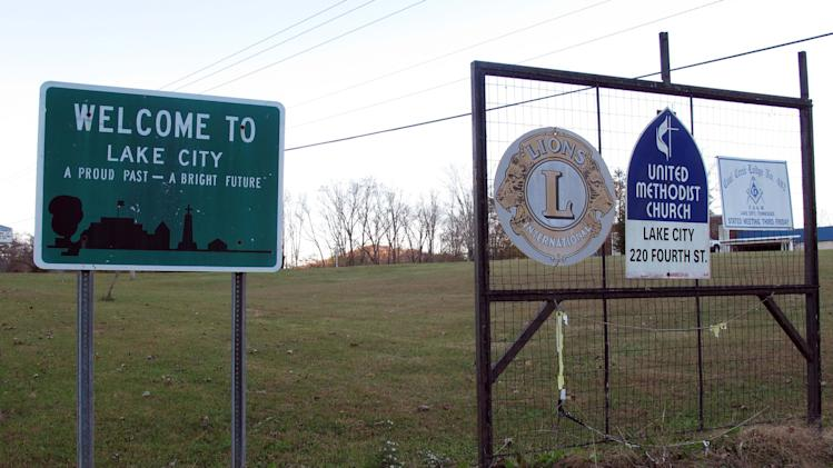 In this Thursday, Nov. 7, 2013 photo, a sign welcomes people to Lake City, Tenn. Residents are considering changing the town's name to Rocky Top in order to cash in on the famous bluegrass song. The city took the first step Thursday, when the council voted in favor of the change. (AP Photo/Travis Loller)