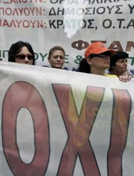 "<p>Greek municipal workers behind a banner, reading: ""No,"" during a demonstration in front of the Finance Ministry in Athens on Wednesday.</p>"